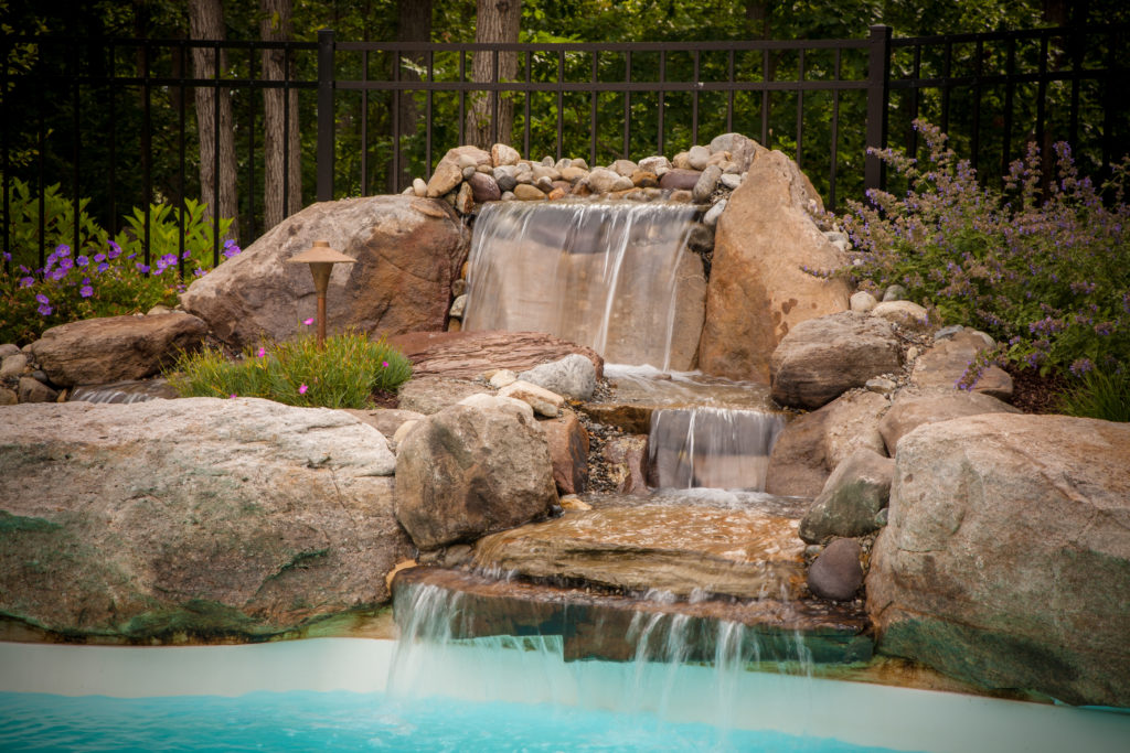 View of natural waterfall feature in pool.