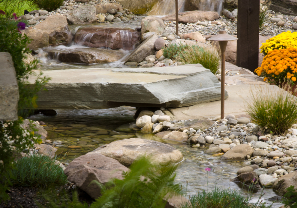 View of small water features in backyard garden.