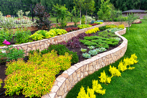 Colorful natural garden with stone terraces.